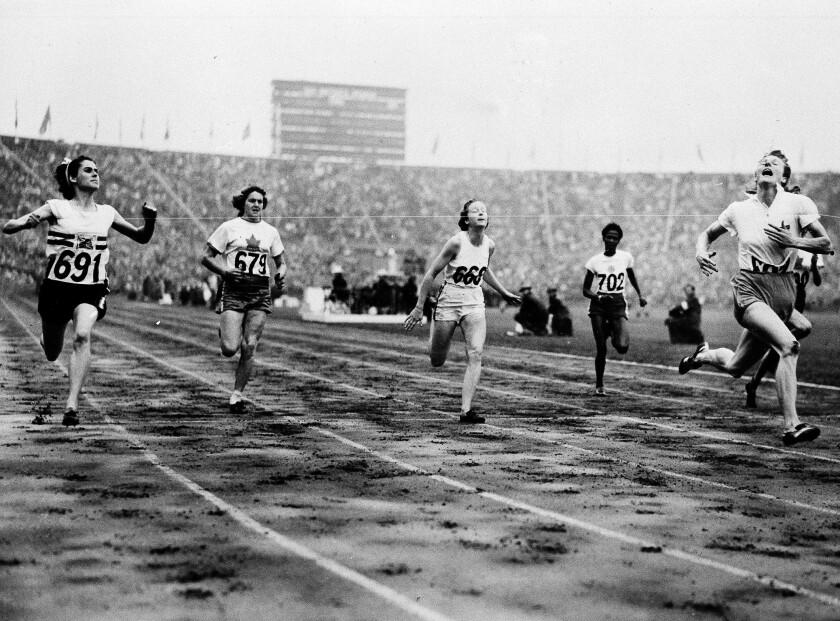FILE - In this Aug. 2, 1948 file photo, Fanny Blankers-Koen, right, of Holland crosses the finish line in 11.9 seconds to win the Women's 100-meter Dash Final in the Olympic Games at Wembley Stadium, Eng. Britain's D. G. Manley (691) is second, Australia's S. B. Strickland (668) third Canada's V. Myers , hidden by camera finishes fourth while teammate Pat Jones (679) finished fifth, and Jamaica's E. Thompson (702) finished sixth. Women were limited in what they could do at the 1948 London Olympics so it was ironic that the biggest personality was a mother of two. Fanny Blankers-Koen was 30, the oldest woman among the track and field entries and considered past her prime. But she won the 100 and 200 meters, the 80-meter hurdles and the 4x100-meter relay. She remains the only female track and field athlete to win four gold medals at a single Olympics. (AP Photo, File)