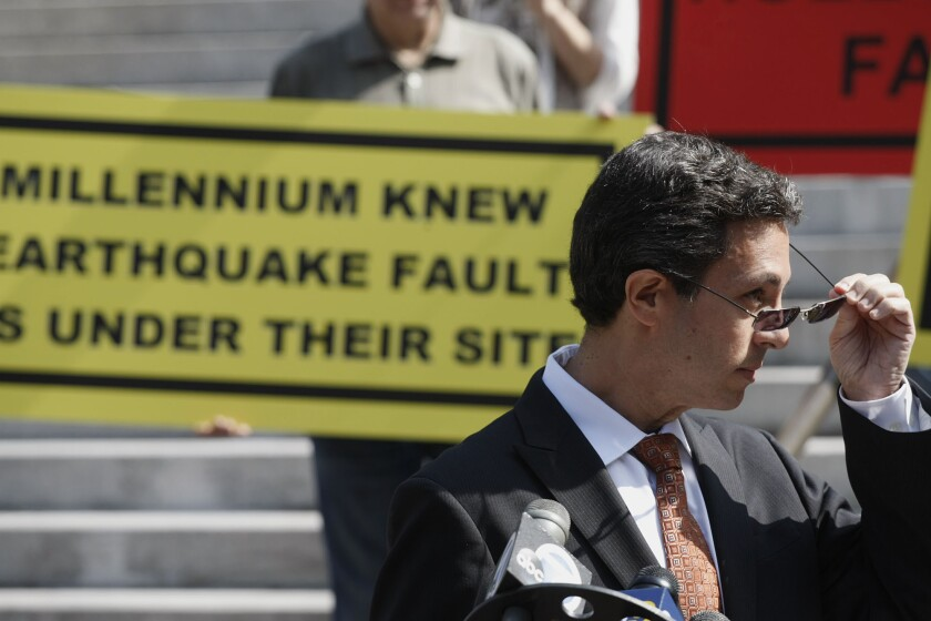 Robert Silverstein, attorney for a coalition of 40 community groups opposed to the Millennium Hollywood project, speaks at a press conference in front of Los Angeles City Hall in Los Angeles.