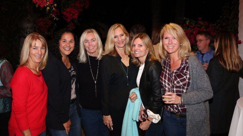 Rowe volleyball coach Jackie Mendez, second from left, at a previous event night held in her honor.