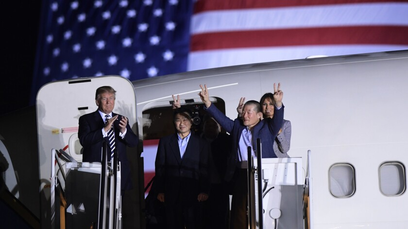 In May, President Trump greets, from left, Tony Kim, Kim Hak Song, seen in the shadow, and Kim Dong Chul, three Americans detained in North Korea for more than a year.