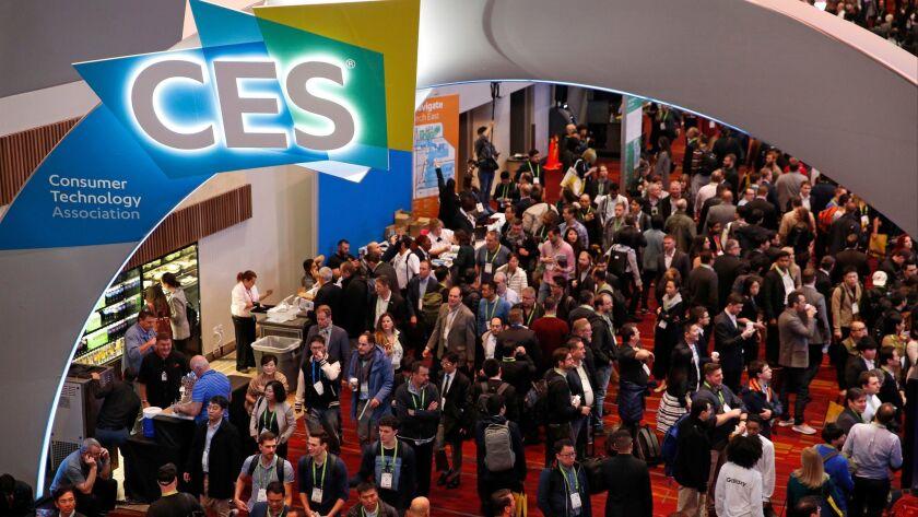 People attend CES International, Tuesday, Jan. 9, 2018, in Las Vegas. (AP Photo/John Locher)