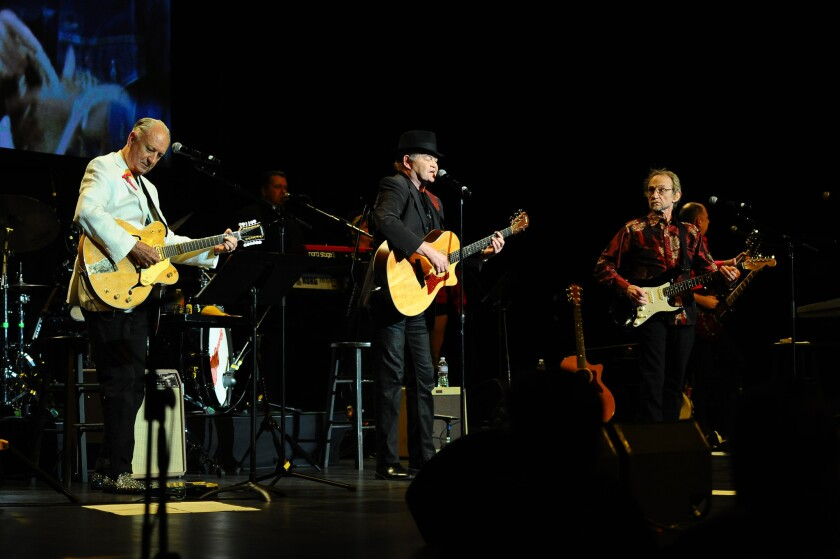 The Monkees' Michael Nesmith, left, Micky Dolenz and Peter Tork at the group's 50th anniversary performance Friday at the Pantages Theatre in Hollywood. Singer Davy Jones died in 2012.