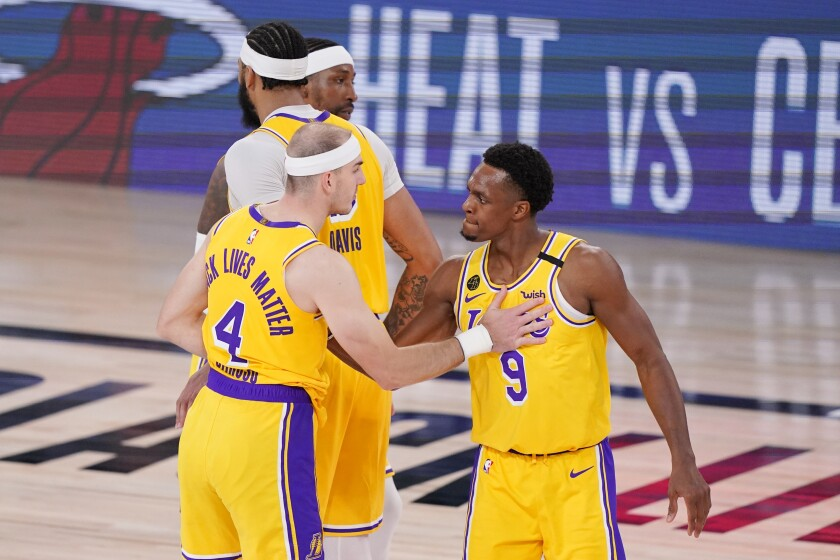 Lakers guard Alex Caruso (4) and Rajon Rondo (9) congratulate one another after beating Denver in Game 4.