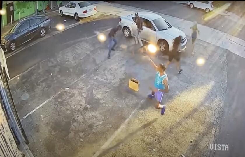 A screenshot shows a man firing a gun at two others while two women run away.