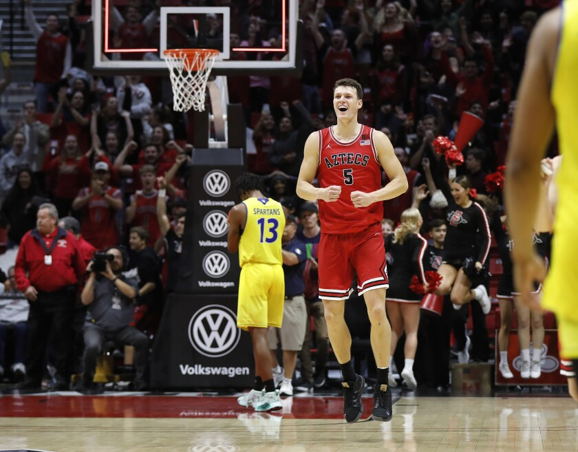 SDSU's Yanni Wetzell celebrates after the win against San Jose State at Viejas Arena.