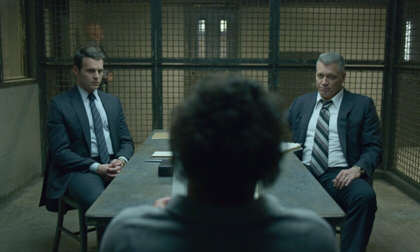 "Jonathan Groff and Holt McCallany conduct an interrogation in Netflix's ""Mindhunter."""