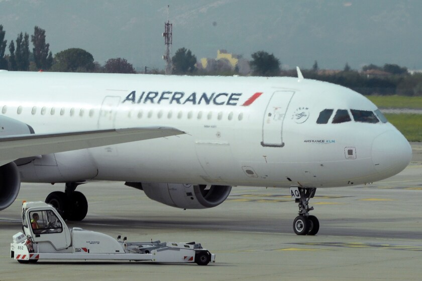 Two Air France planes bound for Paris were diverted and grounded Tuesday evening because of bomb threats, according to the airline.