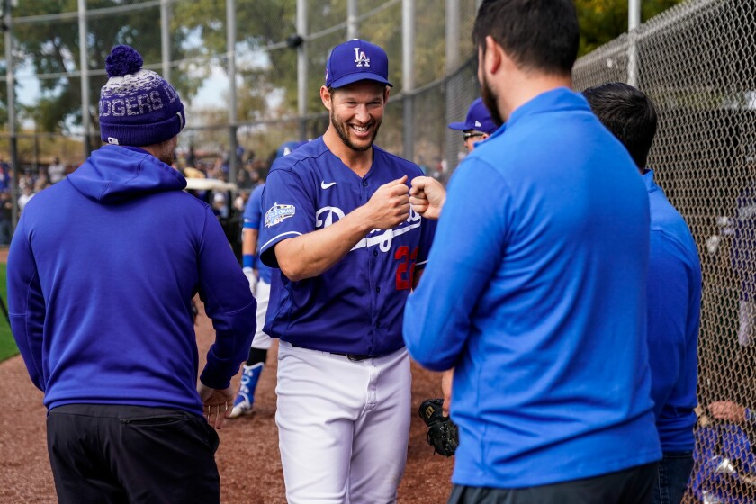 Dodgers pitcher Clayton Kershaw smiles after throwing during live batting practice at spring training on Feb. 23.