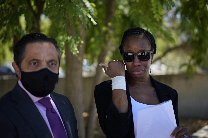 """Lawyer Javier Villalba, left and John McAfee's wife Janice speak briefly with journalists on leaving the Brians 2 penitentiary center in Sant Esteve Sesrovires, near Barcelona, northeast Spain, Friday, June 25, 2021. A judge in northeastern Spain has ordered an autopsy for John McAfee, creator of the McAfee antivirus software, a gun-loving antivirus pioneer, cryptocurrency promoter and occasional politician who died in a cell pending extradition to the United States for allegedly evading millions in unpaid taxes. McAfee's Spanish lawyer, Javier Villalba, said the entrepreneur's death had come as a surprise to his wife and other relatives, since McAfee """"had not said goodbye."""" (AP Photo/Joan Mateu)"""