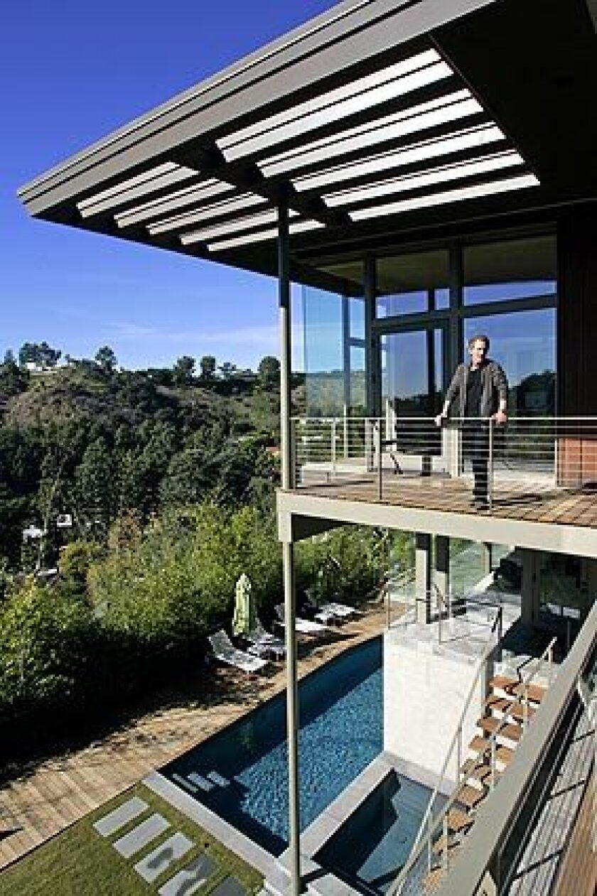 Greta Magnusson Grossman built this 1948 house in Beverly Hills as a quietly dramatic showcase of her skills as an architect and designer of interiors, furniture and lighting. Though she worked in the shadows of midcentury contemporaries such as Rudolph Schindler and Richard Neutra, Grossman maintains a following 10 years after her death — including designer Darryl Wilson, pictured, who bought the home three years ago and recently finished remodeling and expanding it with architect Tony Unruh. The goal: to reconcile the house's past with its future, modernizing it in a way that Grossman might have done herself.