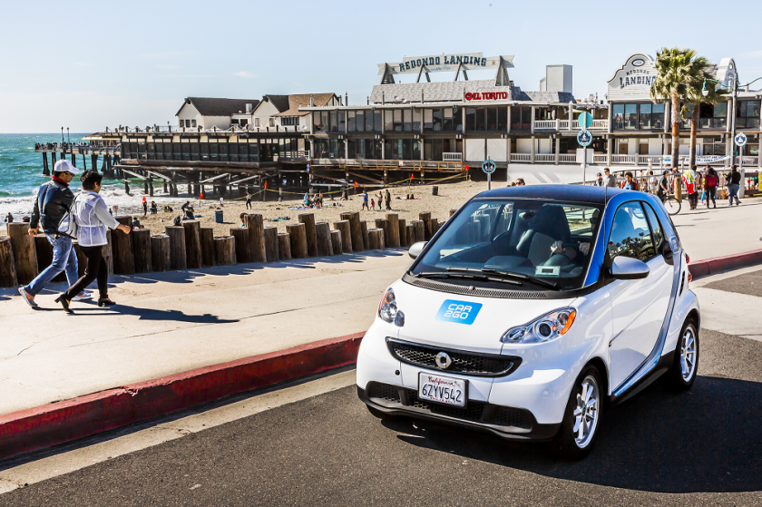 A Car2Go Smartcar cruises past the Redondo Beach waterfront. The car share company launched in the South Bay on Friday, bringing 150 vehicles to the area.