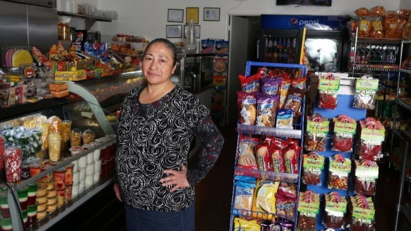 She sold fruit as a sidewalk vendor  Now she has her own shop across