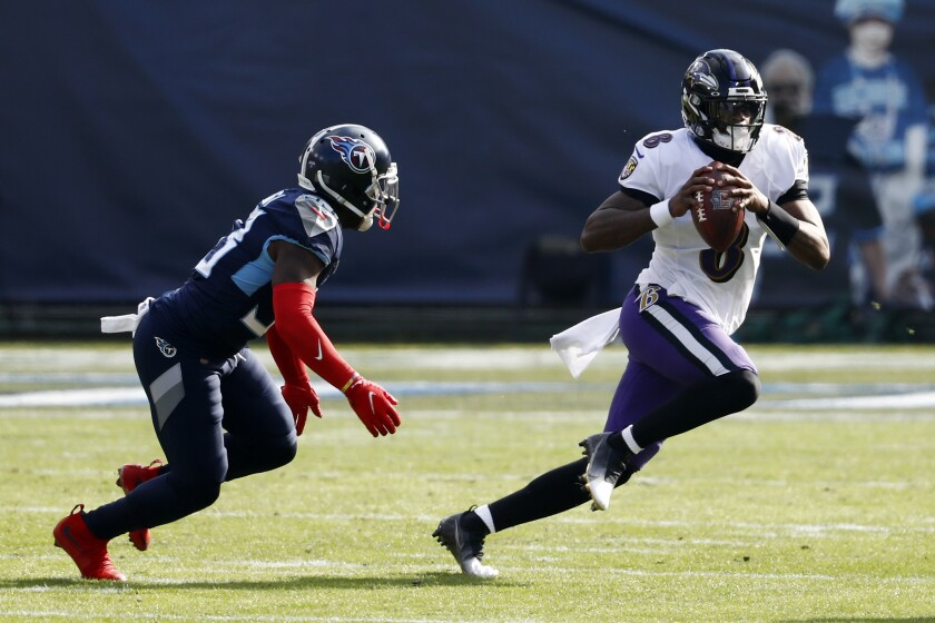 Lamar Jackson leads Ravens to wild-card win over Titans - Los Angeles Times