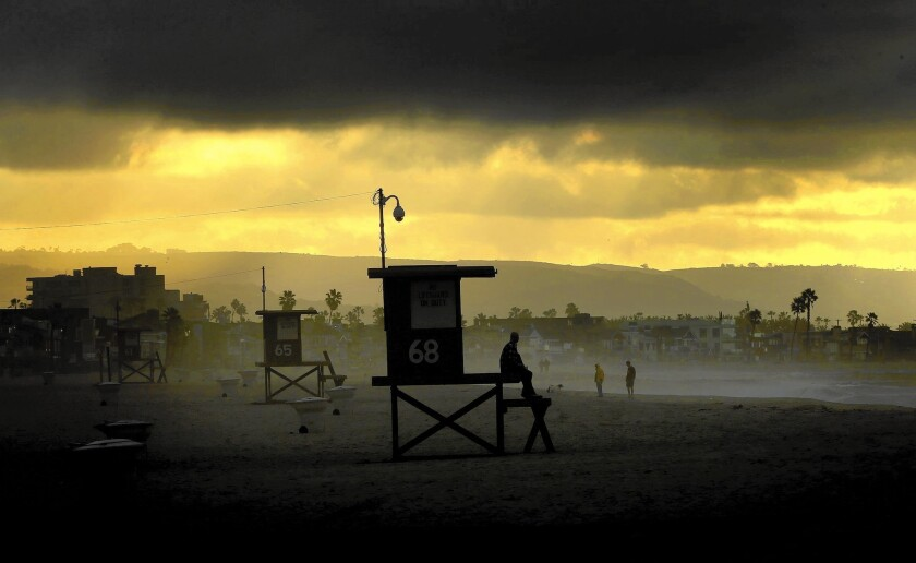 Storm clouds linger in Newport Beach after two days of rain. Scientists differ on exact measurements, but agree that the state has a long way to go to get out of the drought.
