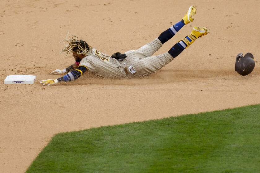 Fernando Tatis Jr. slides into second base with a double