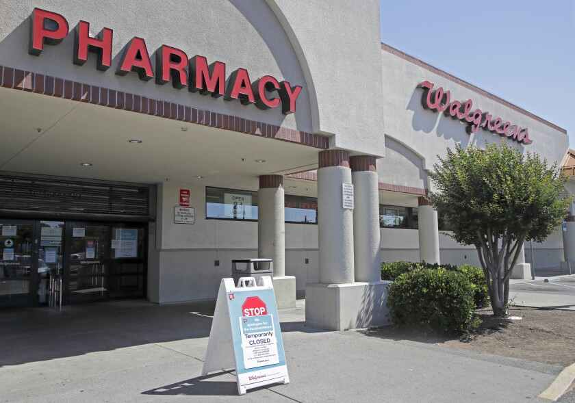 "FILE - This June 3, 2020 file photo shows a sign alerting customers to a closed Walgreens store in Vallejo, Calif. California Attorney General Xavier Becerra announced Friday, June 5, 2020 his office will review the Vallejo police department to reform its use-of-force policies and improve its anti-bias and community policing after officers there shot and killed a 22-year-old man suspected of stealing amid a night of protests. Becerra said the review of the department was not tied to a specific incident but what the Department of Justice called ""several recent high-profile VPD officer-involved shootings."" (AP Photo/Ben Margot, File)"