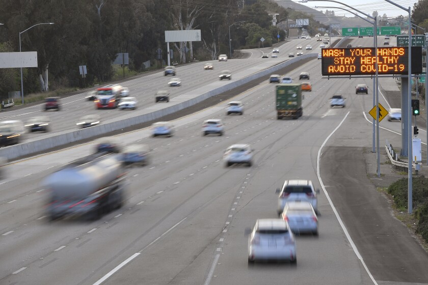 A freeway sign urging people to wash their hands to avoid the coronavirus is seen along the 101 Freeway in Ventura County.