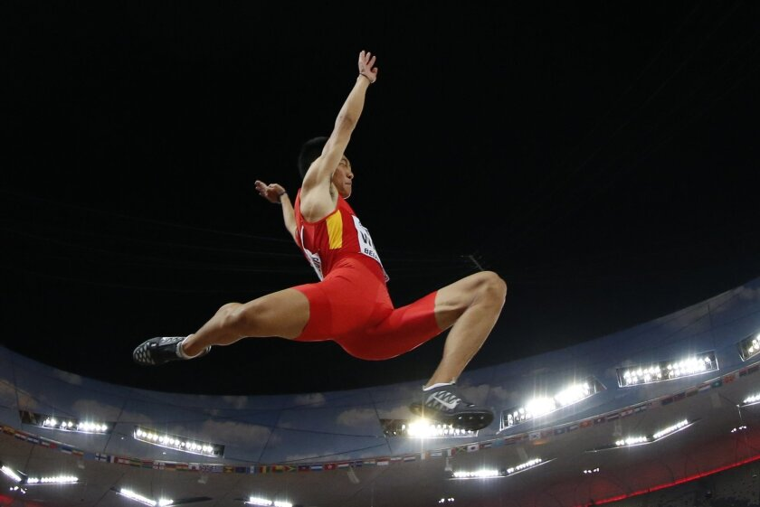 China's Wang Jianan competes in the final of the men's long jump at the World Athletics Championships at the Bird's Nest stadium in Beijing, Tuesday, Aug. 25, 2015. (AP Photo/Andy Wong)