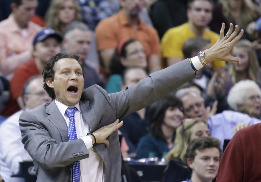 FILE - In this Dec. 11, 2015, file photo, Utah Jazz coach Quin Snyder shouts to his team during the team's NBA basketball game against the Oklahoma City Thunder in Salt Lake City. The Jazz are in position to make the playoffs for the first time since 2011-12 and finish above .500 for the first time