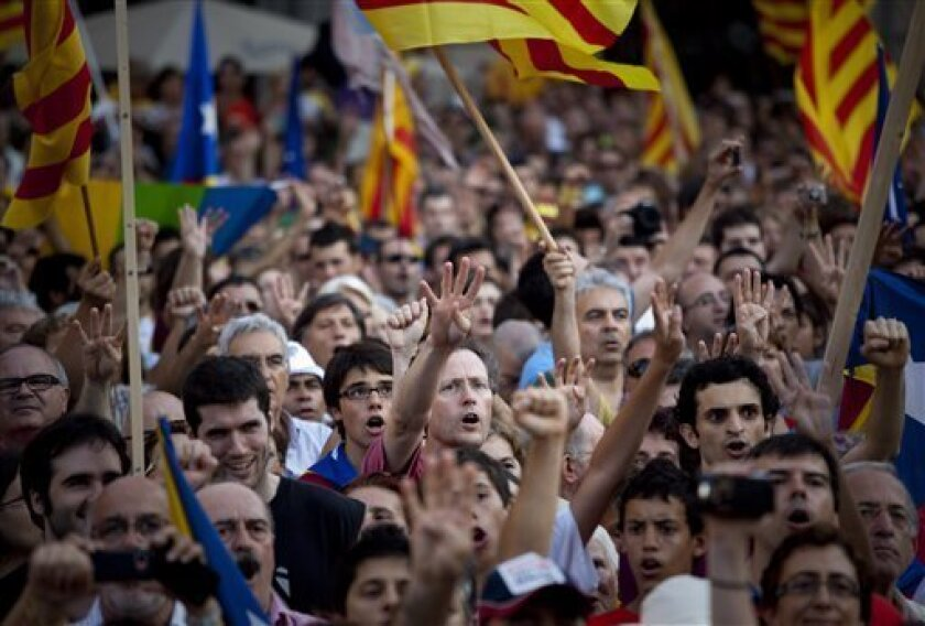 Demonstrators hold catalan flags and shout slogans as they take part in a protest in Barcelona, Spain, Saturday July 10, 2010.  Thousands of demonstrators marched in Barcelona in favor of the Catalan charter that refers to Catalonia as a nation. (AP Photo/Emilio Morenatti)