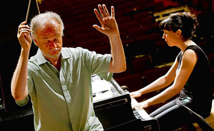 Edward Schmieder conducts as Luiza Borac plays piano during a rehearsal in Hannon Theater at Mount Saint Mary's College in Brentwood for the upcoming iPalpiti Festival.