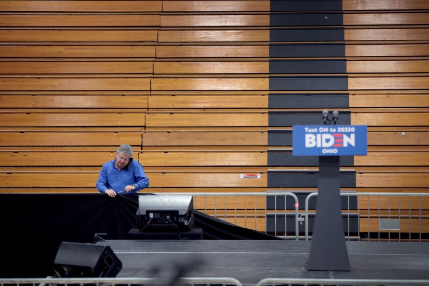 Workers tear down the setup for a canceled Joe Biden election-night rally in Cleveland on March 10.