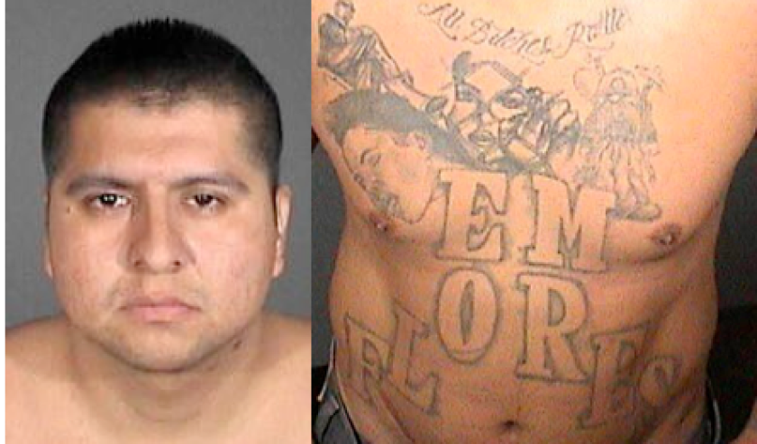 Photo shows Johnny Mata and his tattoos. He is wanted in connection with a 2010 killing.