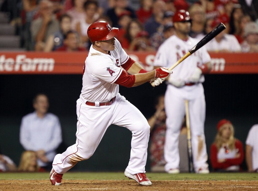 Los Angeles Angels' Mike Trout hits a game-winning solo home run in the ninth inning of a baseball game against the Houston Astros on Friday, July 4, 2014, in Anaheim, Calif. The Angels won 7-6. (AP Photo/Alex Gallardo)