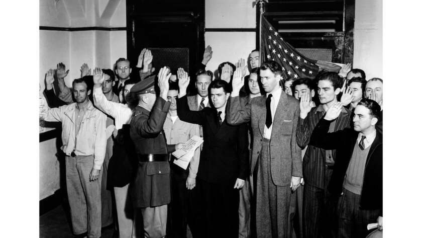 """March 22, 1941: Actor James """"Jimmy"""" Stewart, third from right in front row, being sworn into the U.S. Army."""
