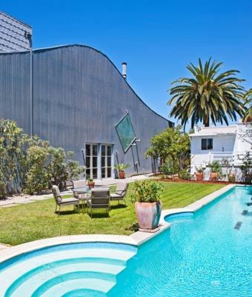 The longtime residence of Dennis Hopper includes an art barn-style main residence and a 100-year-old bungalow as well as three condominiums and a pool.