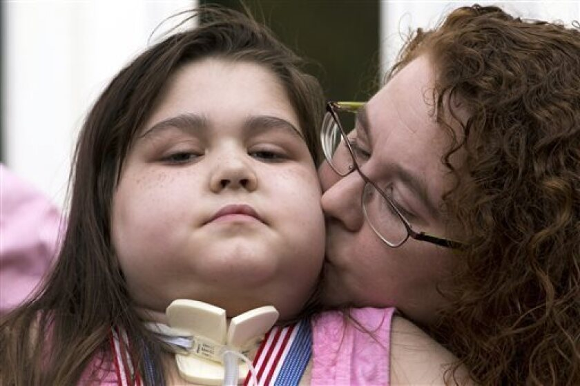 Lung transplant recipient Sarah Murnaghan, 11, with her mother, Janet, after arriving home from the hospital.