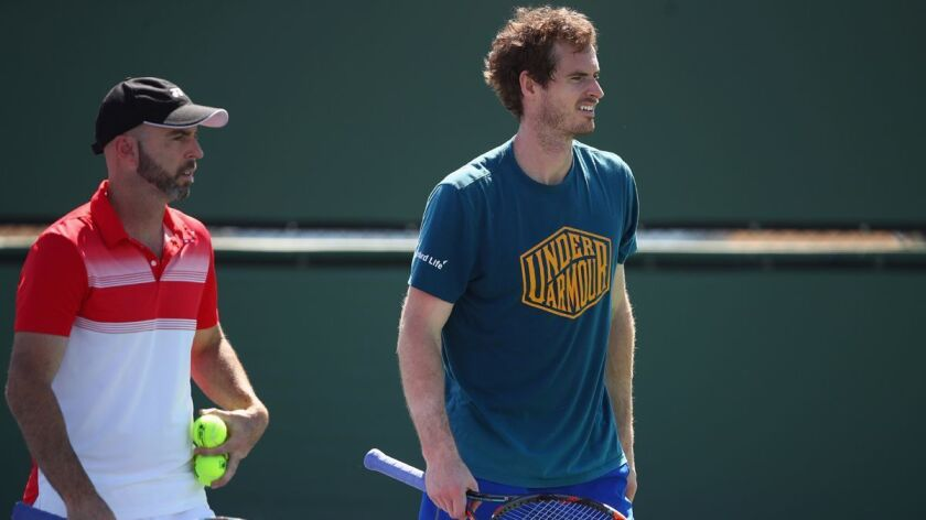 Andy Murray, right, works with Coach Jamie Delgado during his practice session Wednesday at the BNP Paribas Open at Indian Wells Tennis Garden.