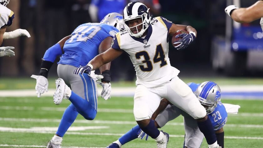 Rams running back Malcolm Brown looks for yardage against Detroit on Dec. 2.