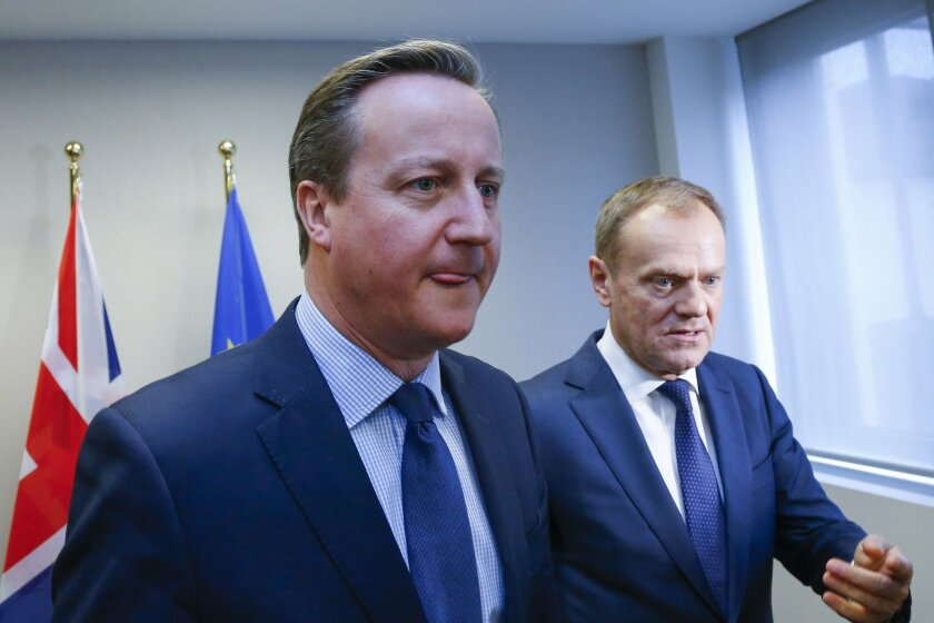 British Prime Minister David Cameron, left, walks with with European Council President Donald Tusk during a bilateral meeting on the sidelines of an EU summit in Brussels on Thursday, Feb. 18, 2016. European Union leaders are holding a summit in Brussels on Thursday and Friday to hammer out a deal