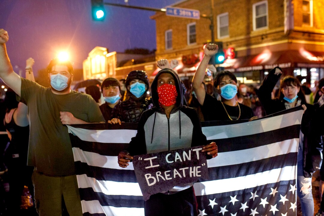 Protesters gather near the place where George Floyd died in custody in Minneapolis.