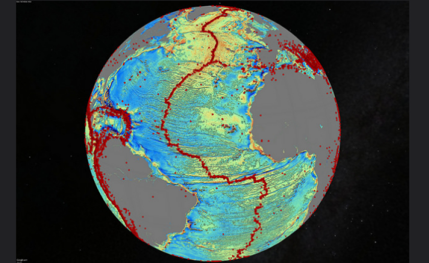 A marine gravity model of the North Atlantic. Red dots show locations of earthquakes with magnitude above 5.5 and highlight the location of seafloor ridges and faults.
