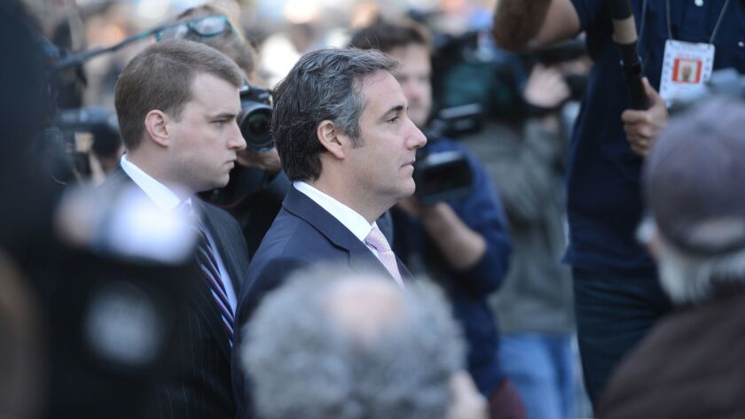 Michael Cohen exits the federal courthouse in Manhattan last month. A new letter said he knew about abuse allegations against New York Atty. Gen. Eric Schneiderman long before they were revealed publicly this week.