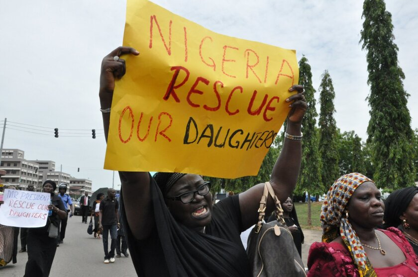 """An unidentified mother cries out during a demonstration with others who have daughters among the kidnapped school girls of government secondary school Chibok, Tuesday April 29, 2014, in Abuja, Nigeria. Two weeks after Islamic extremists stormed a remote boarding school in northeast Nigeria, more than 200 girls and young women remain missing despite a """"hot pursuit"""" by security forces and desperate parents heading into a dangerous forest in search of their daughters. Some dozens have managed to escape their captors, jumping from the back of an open truck or escaping into the bush from a forest hideout, although the exact number of escapees is unclear. (AP Photo/ Gbemiga Olamikan)"""
