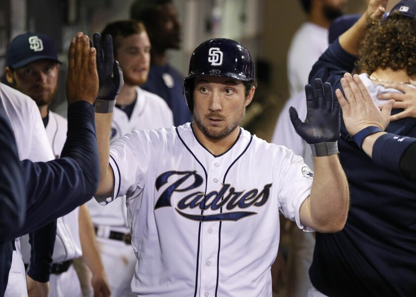 The Padres' Brett Wallace is congratulated in the dugout after he hit a home run in the seventh inning.
