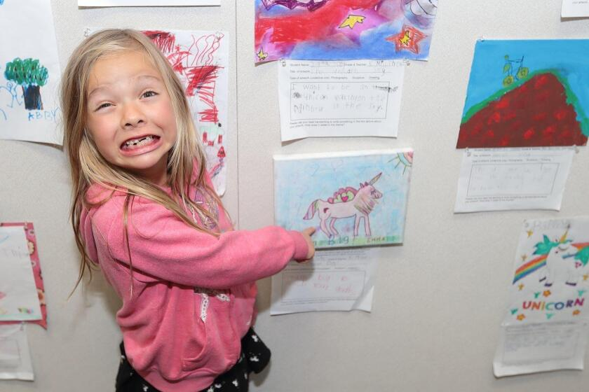 """Emma Tate with her drawing """"Dream Big"""""""
