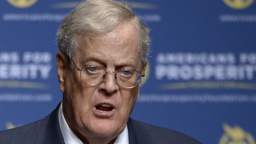 FILE - In this Aug. 30, 2013 file photo, Americans for Prosperity Foundation Chairman David Koch spe
