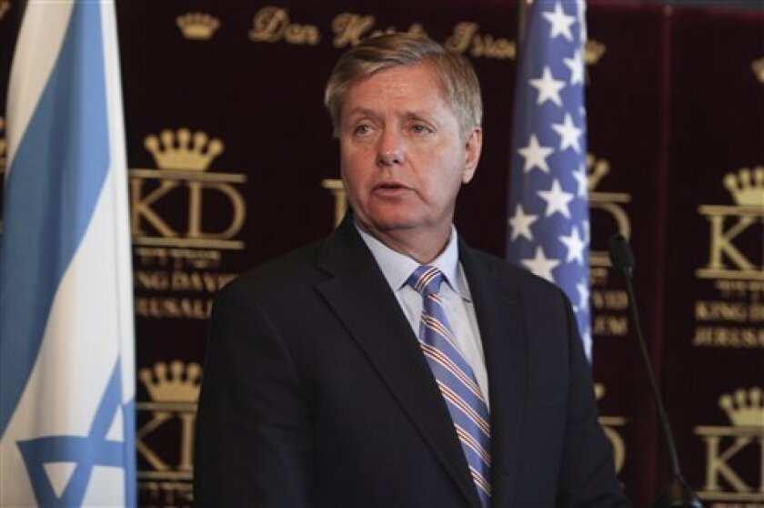 US Sen. Lindsey Graham, R-S.C. stands before a press conference in Jerusalem, Wednesday, April 27, 2011. Support for the Obama administration's use of Predator drone aircraft in Libya is coming from a top Republican, Sen. Lindsey Graham of South Carolina. Graham says Predators should target Libyan