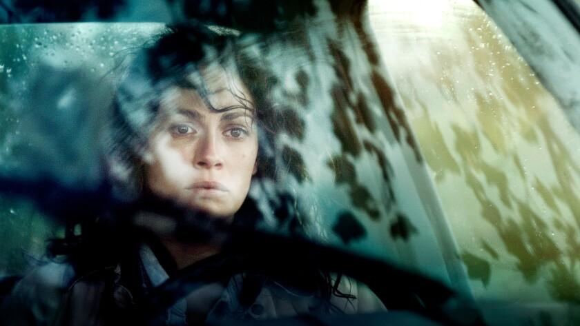 "Joanne Kelly as Betty in the movie ""Runoff."""