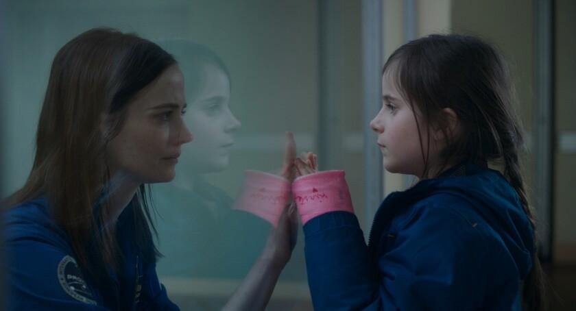 "Eva Green, left, and Zélie Boulant-Lemesle in the movie ""Proxima."""