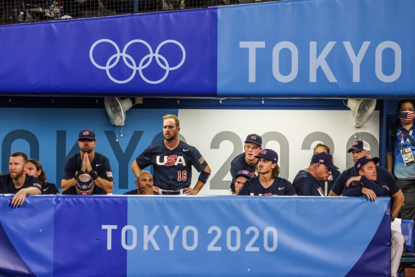 U.S. baseball players watch the field somberly at the Tokyo Olympics.