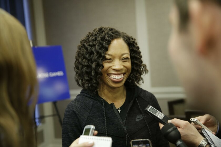 Allyson Felix talks to reporters in New York, Thursday, Feb. 18, 2016. Now that international track and field officials have shifted the schedule at the Rio Olympics, American star Allyson Felix will have a chance to win double gold in the 200 and 400 meters. (AP Photo/Seth Wenig)