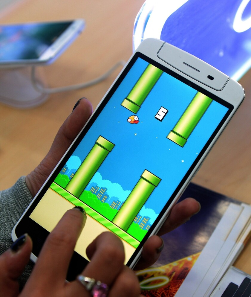 Since Flappy Bird, shown above, was removed from Google Play, fake versions of the game containing malware have sprung up around the Internet.
