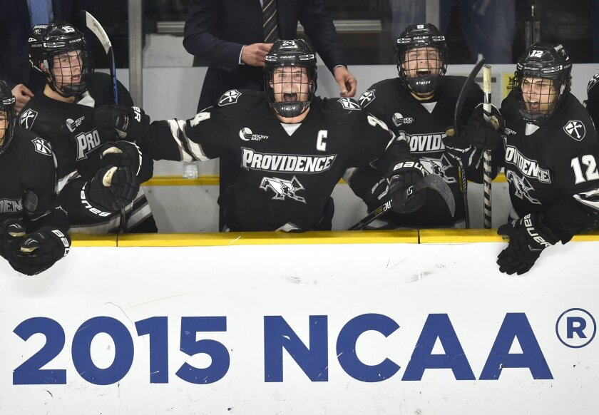 Stefan Demopoulos (far right), one of several San Diego-born players at the NCAA Division I level of ice hockey, celebrates a Providence goal with teammates en route to the national championship last spring. (AP Photo/Gretchen Ertl)