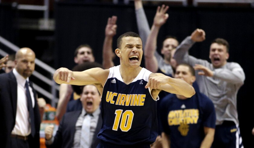 UC Irvine guard Luke Nelson celebrates after making a three-point shot against UC Santa Barbara in overtime of their Big West tournament semifinal on Friday night.