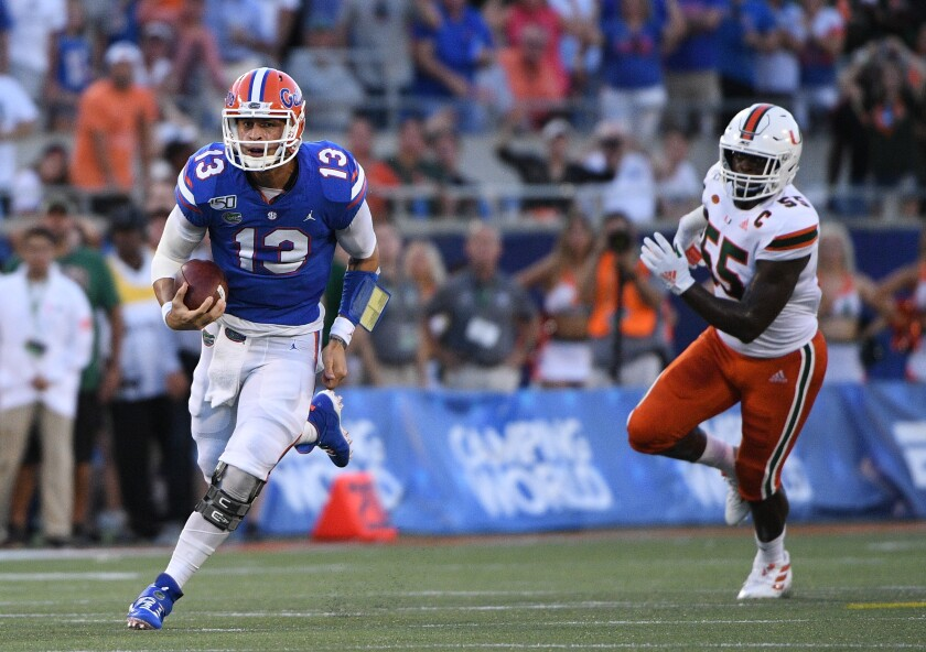 Florida quarterback Feleipe Franks (13) runs for a first down in the first half against Miami on Saturday in Orlando, Fla.